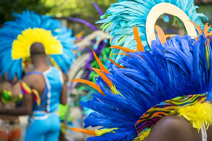 Pride in the US: Men in feathered costumes celebrate Pride © lazyllama / Shutterstock