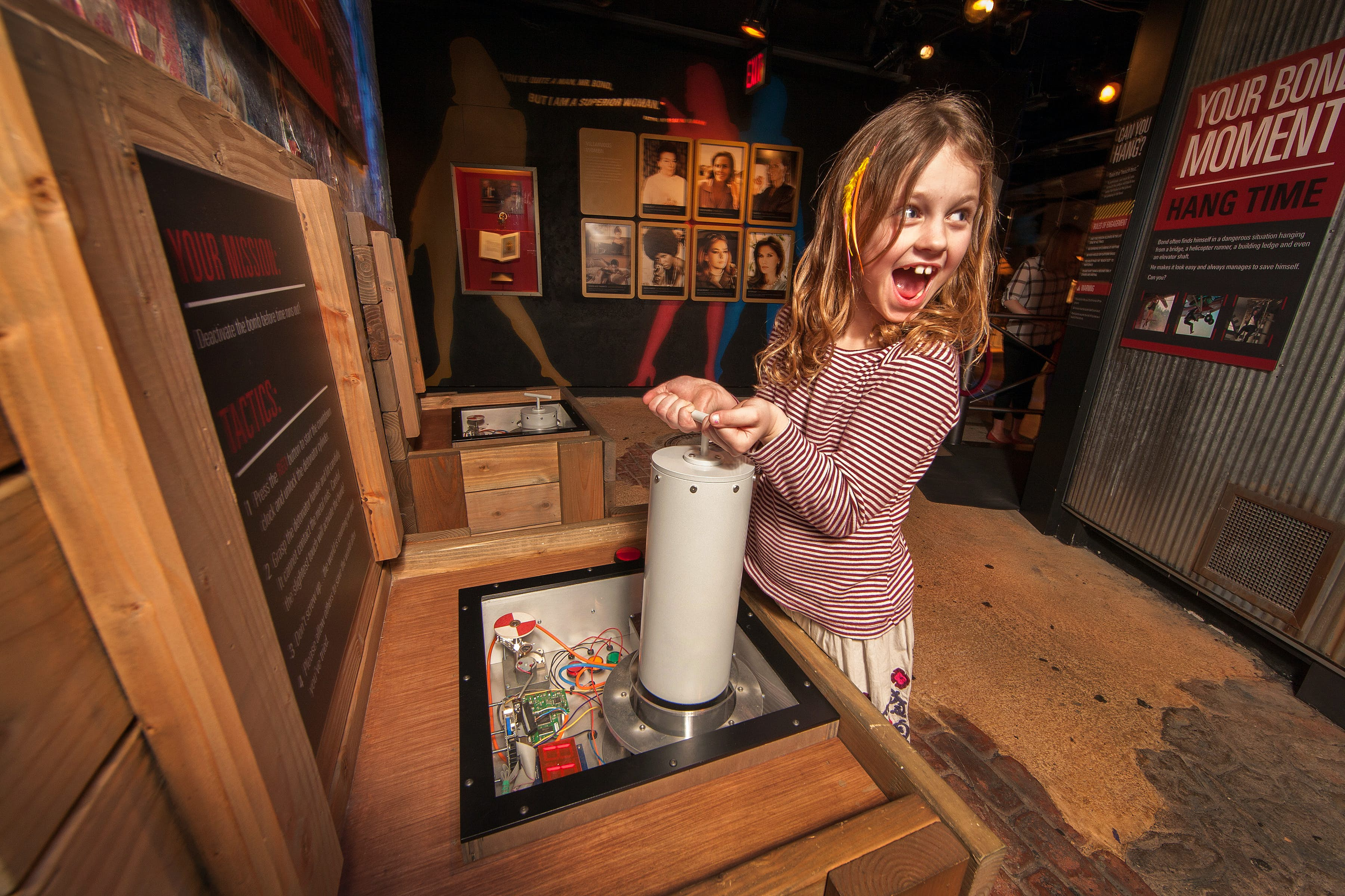 Excited girl experiments with spy equipment at the International Spy Museum © International Spy Museum