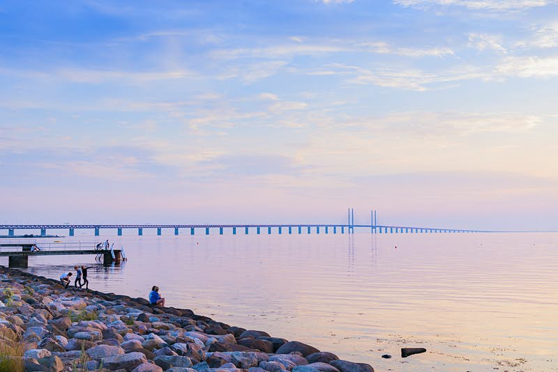 "Features - ""Sweden, Skane, Malmo, Sibbarp, Rocky coastline at sunset"""