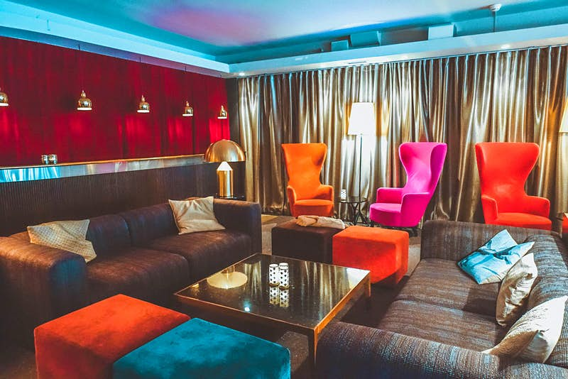 Interior shot of Hotel Rival, showing the colourful, plush furniture in the lounge area © Megan & Whitney Bacon-Evans / Lonely Planet