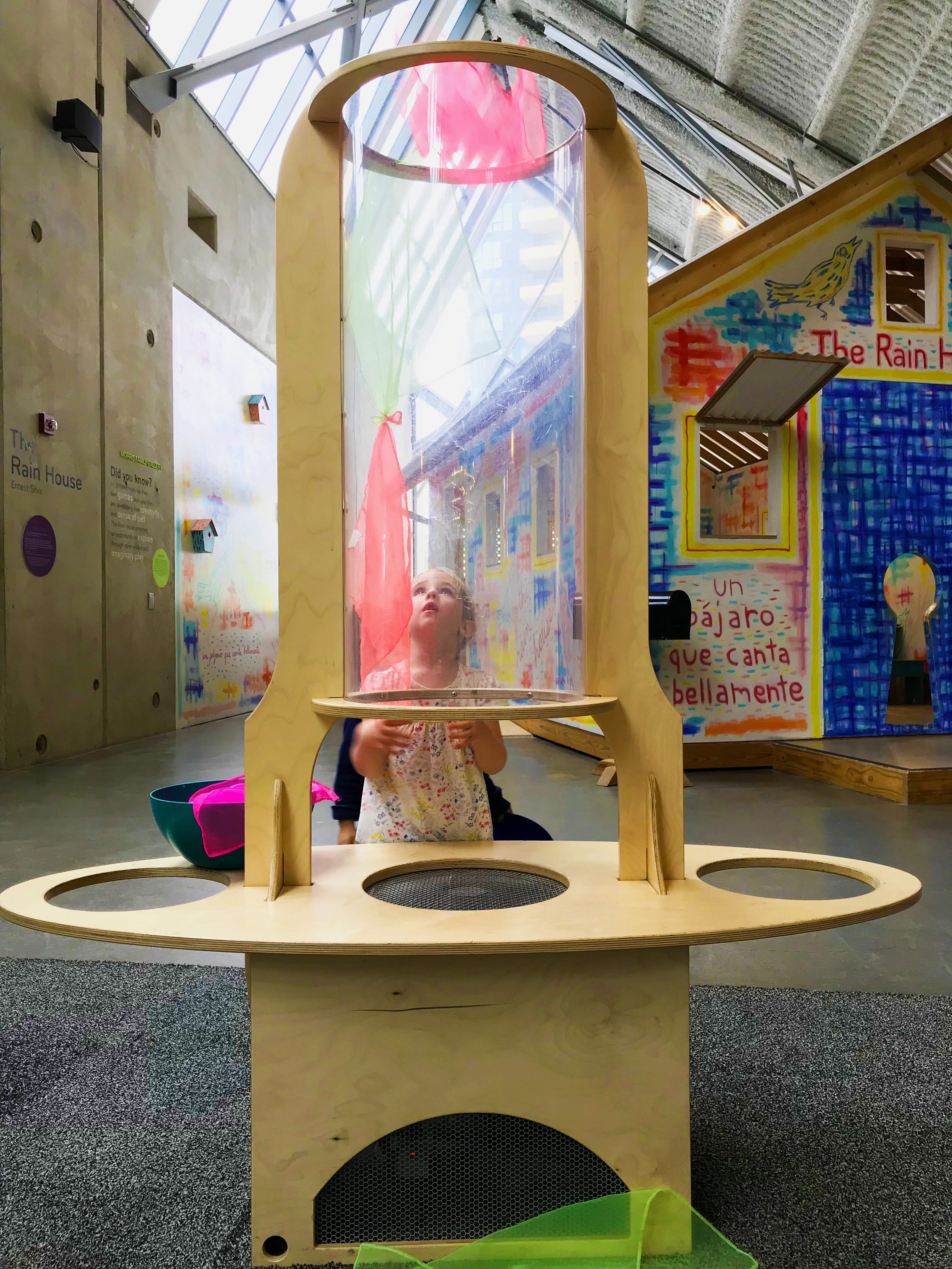 Girl plays with a scarf wind tunnel at The New Children's Museum in San Diego © Sarah Stocking / Lonely Planet
