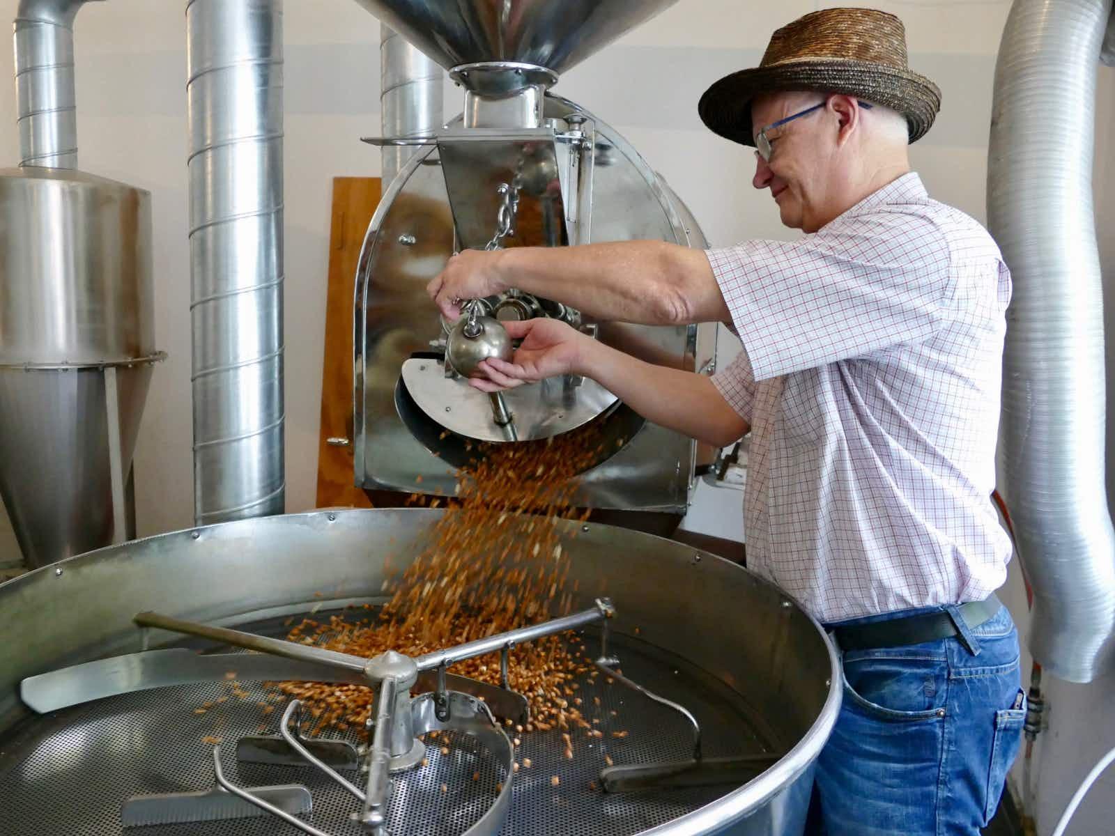 Miller Ilario Garbani roasting corn to make Farina Bóna (good flour) in Ticino, Switzerland © Sarah Gilbert / Lonely Planet