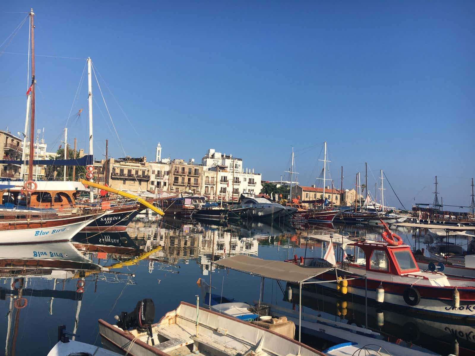 Fishing boats and traditional wooden ships moored in Kyrenia's old harbour © Brana Vladisavljevic / Lonely Planet