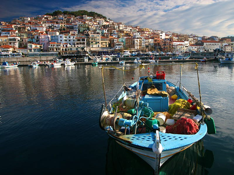 A fishing boat laden with nets lolls in the harbour on the Northeastern Aegean island of Lesvos© Tan Yilmaz / Getty Images
