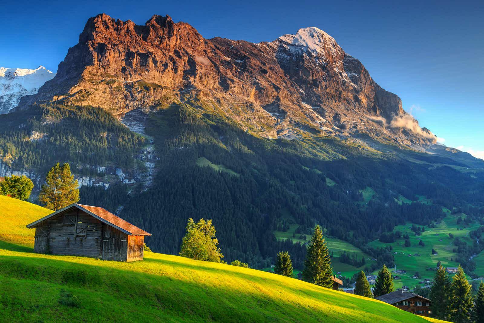 A mountain hut under the shadow of the Eiger mountain in Switzerland © Gaspar Janos / Shutterstock