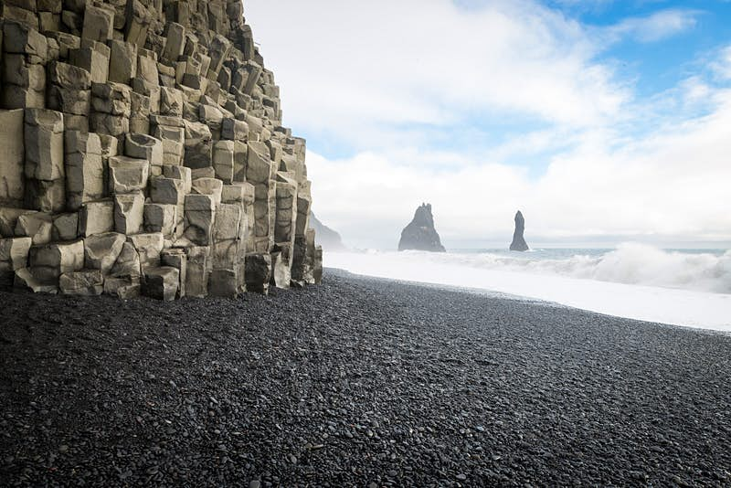The craggy cliffs and black sand of Reynisfjara beach, Iceland © Elena Pueyo / Getty Images