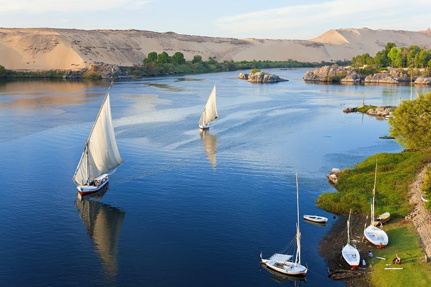 Felucca sailboats on the River Nile in Aswan, Egypt © Peter Adams / Getty Images