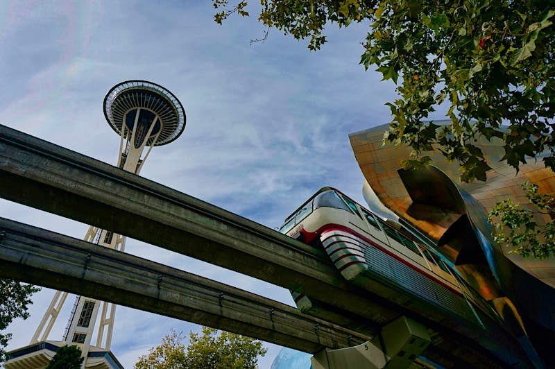 The Space Needle, with the Monorail in the foreground, were constructed for the 1962 World's Fair