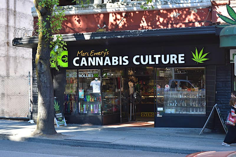 A shop with a black awning and large windows filled with cannabis-smoking paraphernalia in Canada, where you can now legally purchase pot