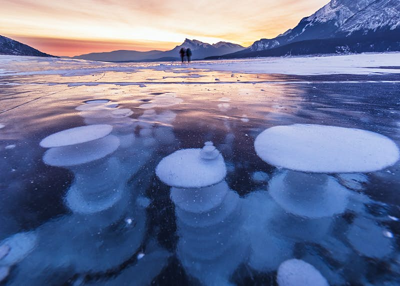 Bubbles trapped in the frozen water of Abraham Lake, Canada