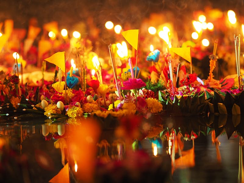 Decorative krathong, or floating banana leaf boats, are sent out to river to pay respects to the Goddess of Water