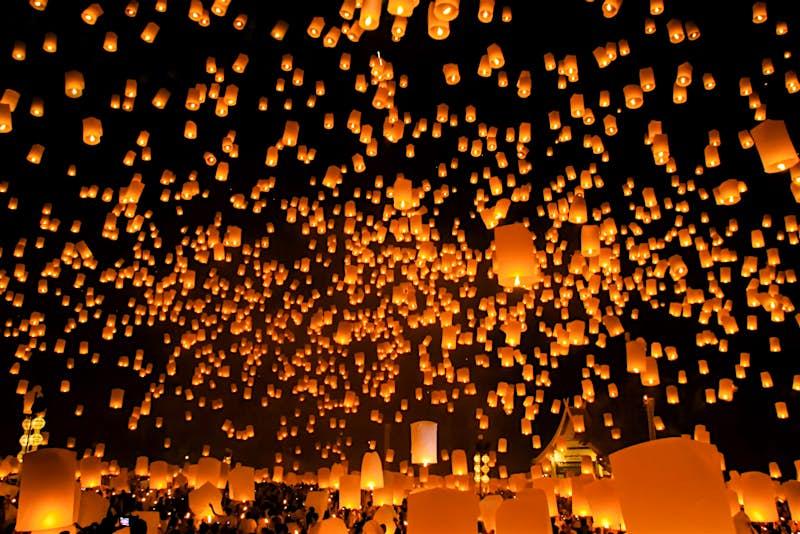 Bright lanterns light the sky in Chiang Mai for Loi Krathong