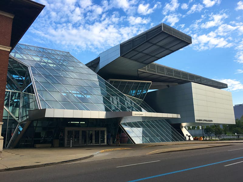 Exterior shot of the Akron Art Museum, a modern glass and concrete building