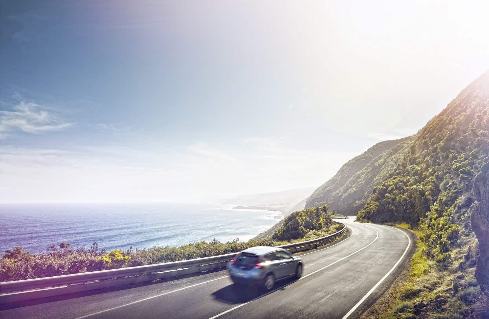 Car driving on the Great Ocean Road Australia