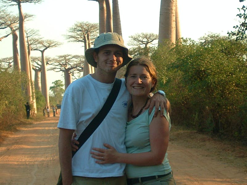Imogen and Tom Hall pose in front of the baobab trees in Madagascar.
