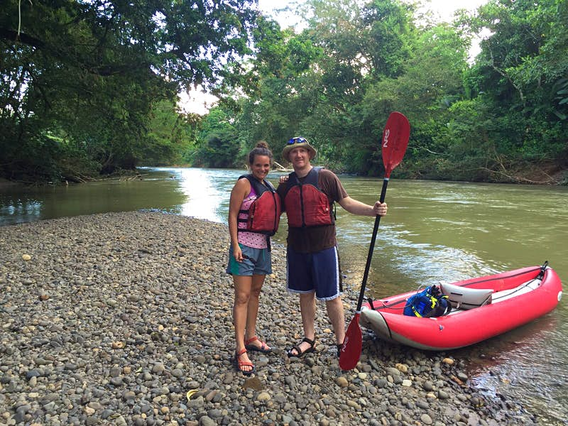 Ben and his new wife pose with an inflatable canoe in Costa Rica.
