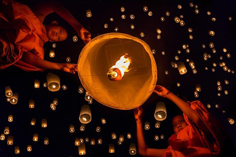 Novice monks release a lantern during Loi Krathong in Chiang Mai