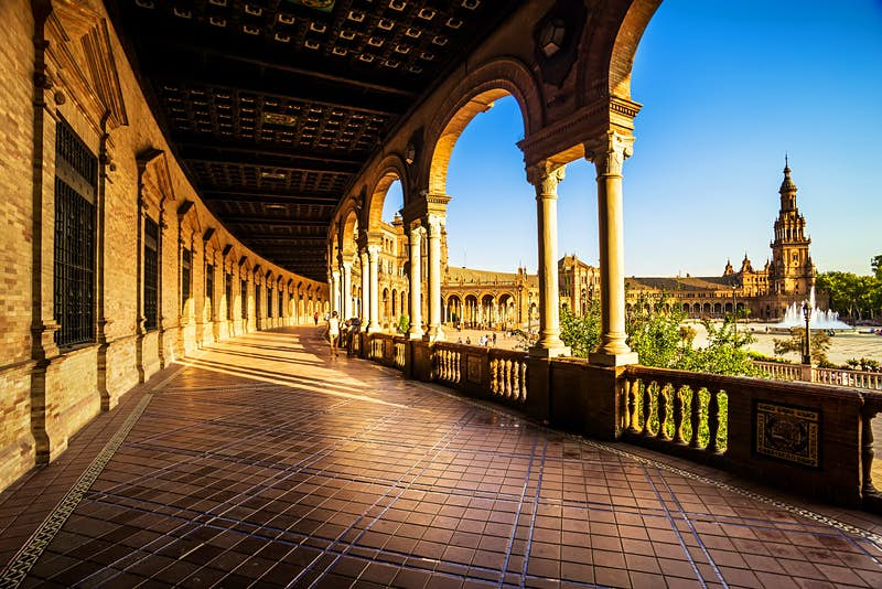 A view of the covered walkway around Plaza de Espana, Seville, Spain