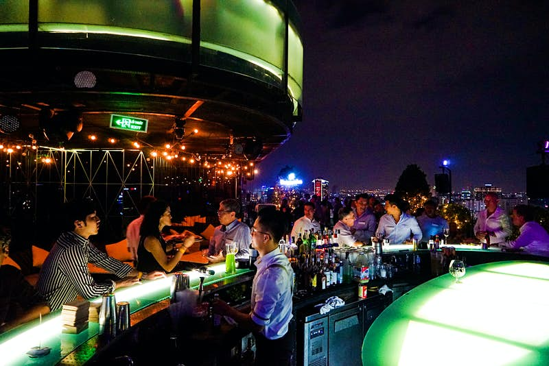 People relax under the night sky at Air 360