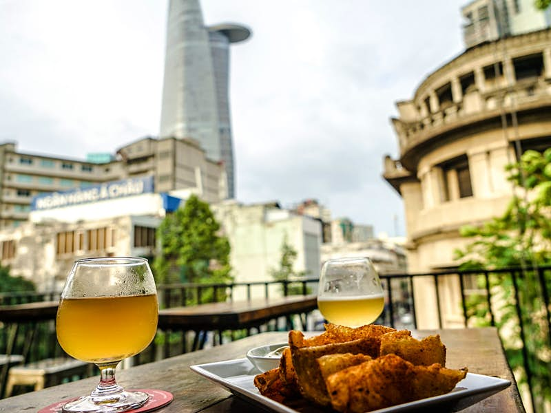 Craft beer and chips overlooking Ho Chi Minh City at Rogue
