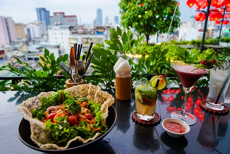 A salad and a cocktail at the View. The leafy, green salad is in an edible chip bowl.