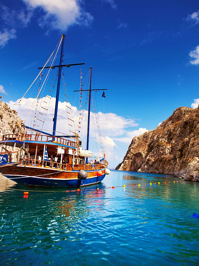 An island-hopping yacht moored in a secluded cove on Kalymnos island in the Dodecanese © Matt Munro / Lonely Planet
