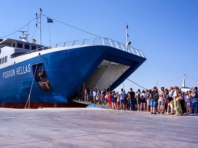 Travellers board a ferry in the port of Aegina island in the Saronic Gulf© Rolf G Wackenberg / Shutterstock