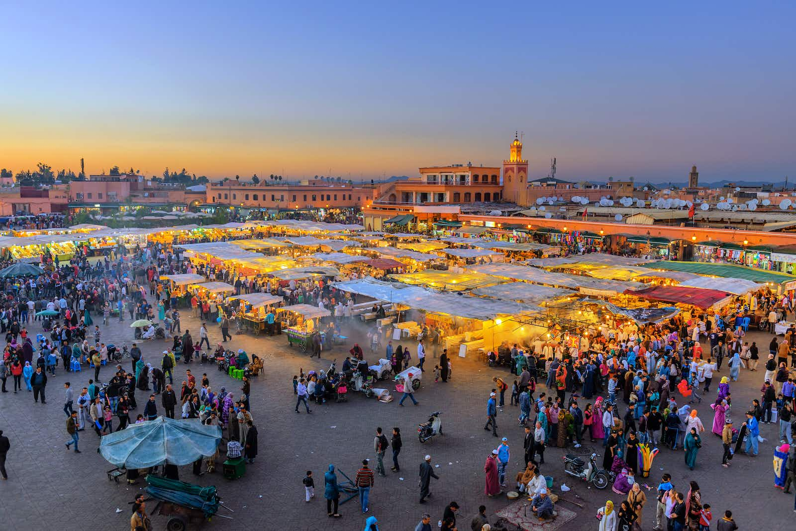 Famous Djemaa El Fna Square in early evening light, Marrakech, Morocco with the Koutoubia Mosque, Northern Africa.Nikon D3x