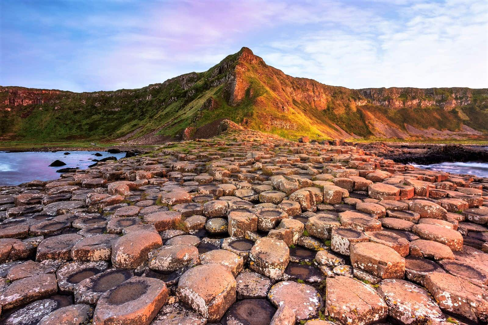 A view of the Giant's Causeway's rock formations at sunset.