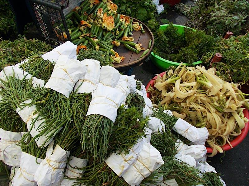 Wild greens stacked in a market in Urla, Turkey