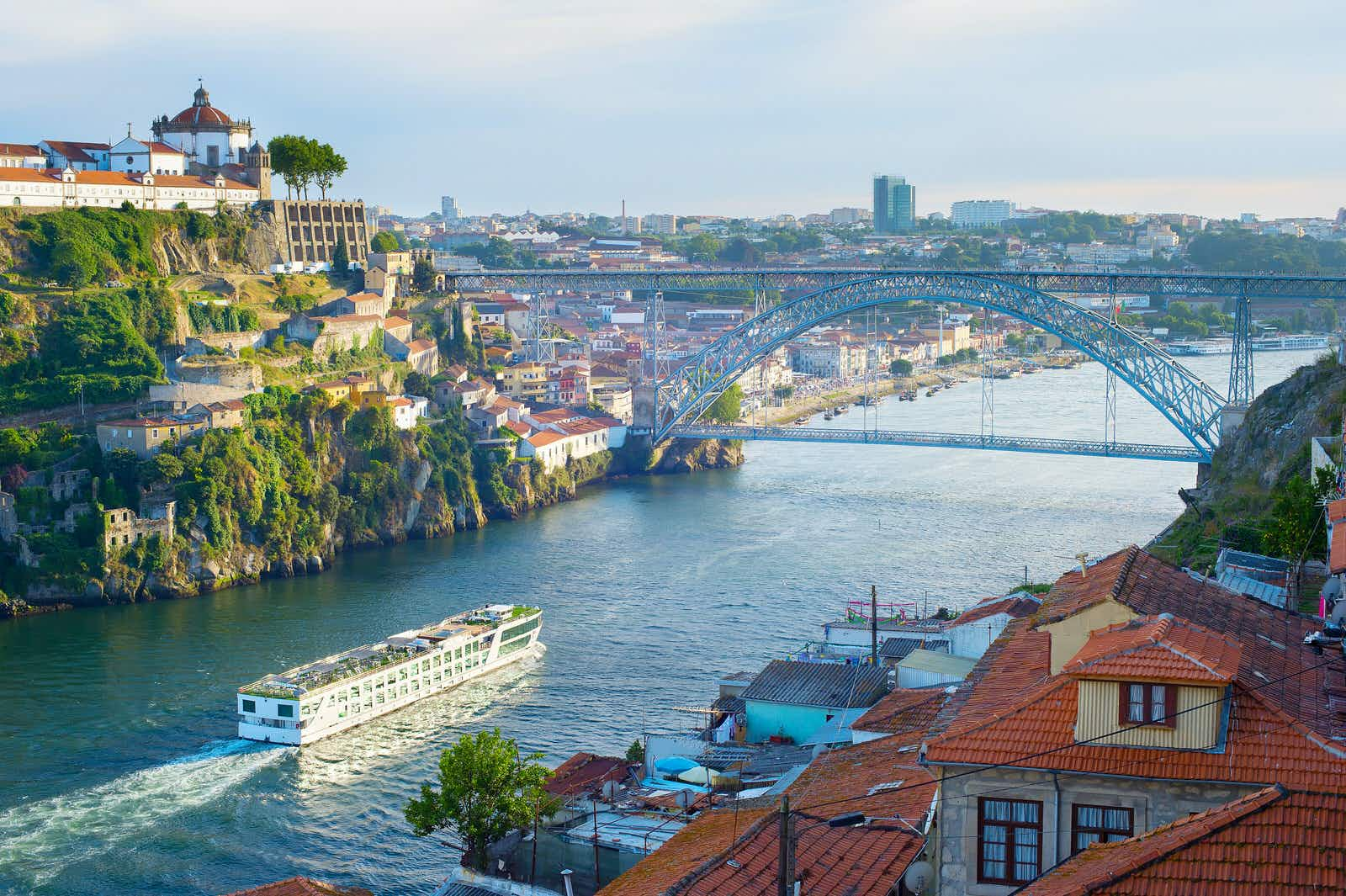 A cruise ship arrives in Porto on the river Douro.