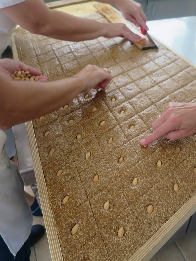 Traditional melekouni is a Rhodian energy snack of sesame seeds and honey