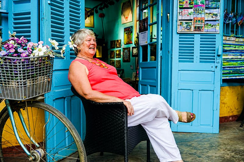 Artist and communicator Bridget March relaxes outside her Hoi An shop