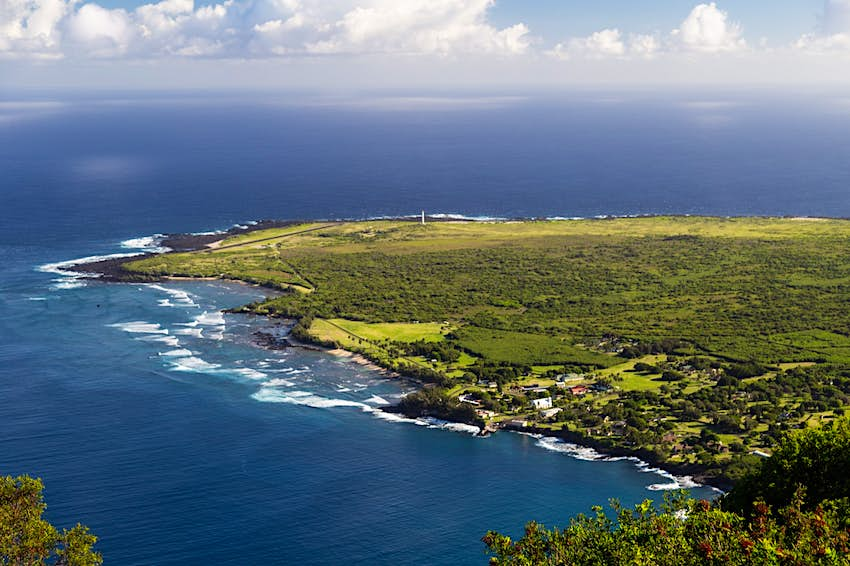 Looking down at the peninsula of Kalaupapa from the top of one of the nearby cliffs, with a tiny village visible on the near shore
