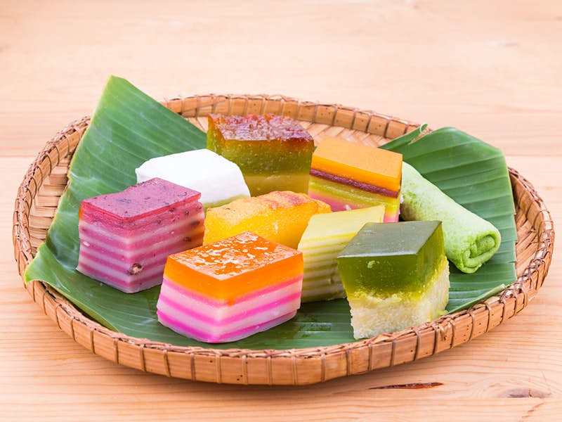 Assorted brightly coloured Peranakan rice cakes known as kueh