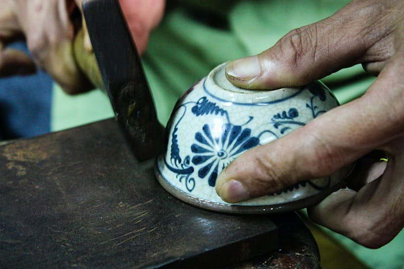 Decorative accents are added at Reaching Out, a workshop in Hoi An