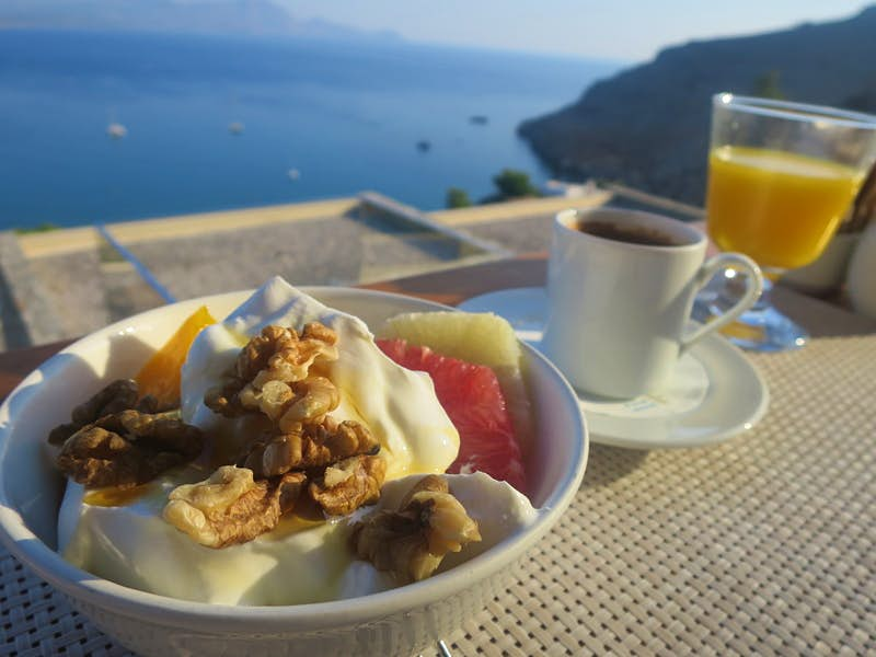 Greek yoghurt, walnuts, honey and fruit served for breakfast on Rhodes island