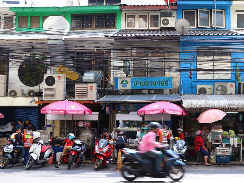 Phahon Yothin 7 in Ari district, lined with street food stalls, seamstresses and cobblers