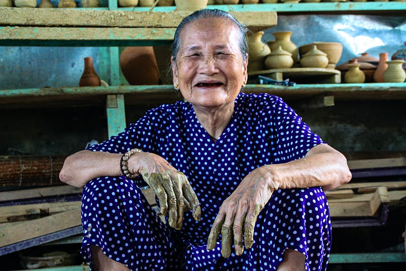 Portrait of Mrs Phu who still throws pottery in Thanh Ha Village, near Hoi An