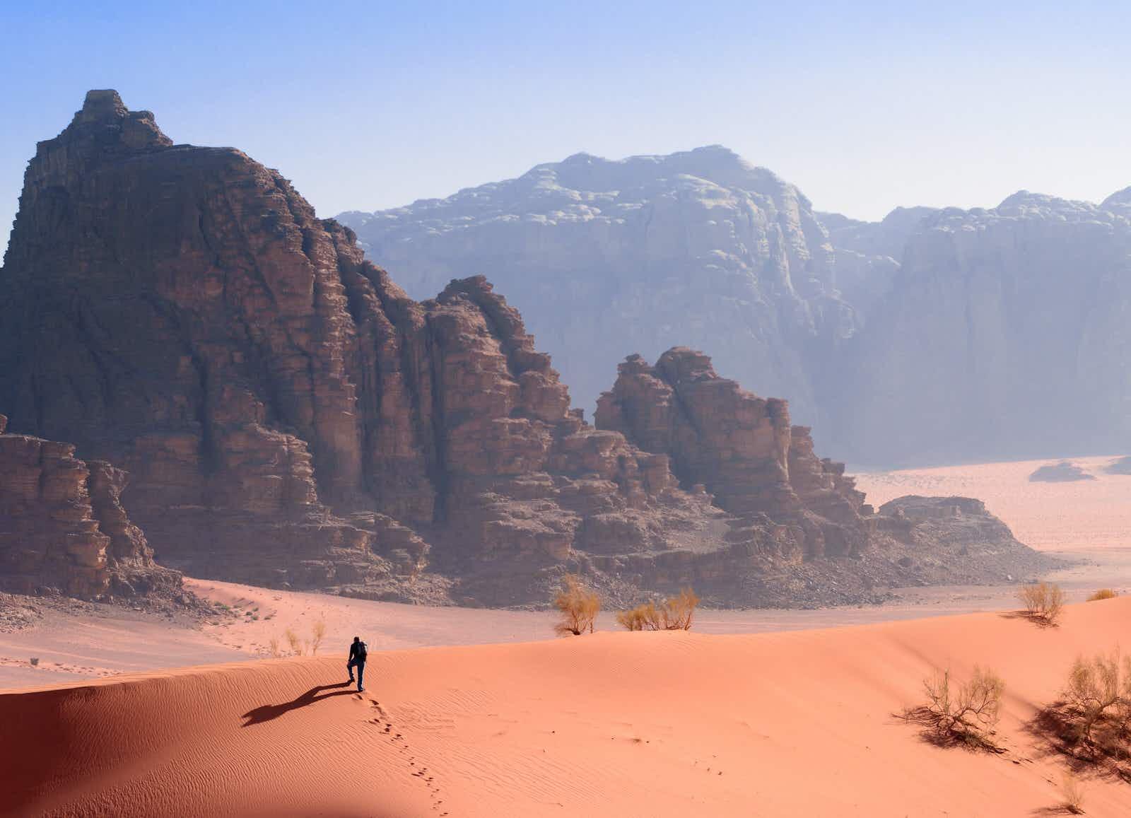 A Hiker on a Ridge in the Desert in Wadi Rum, Jordan