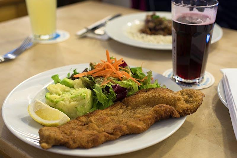 Munich society - a schnitzel dish served at Conviva im Blauen Haus, Munich © Kate Mann / Lonely Planet
