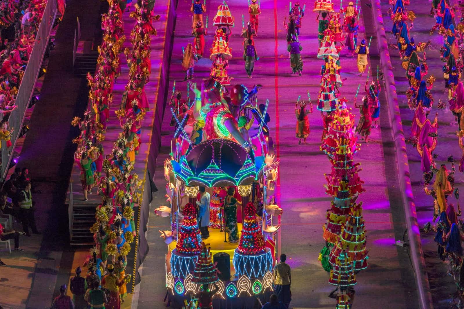 An large float covered in bright lights makes its way down the Chingay parade path.