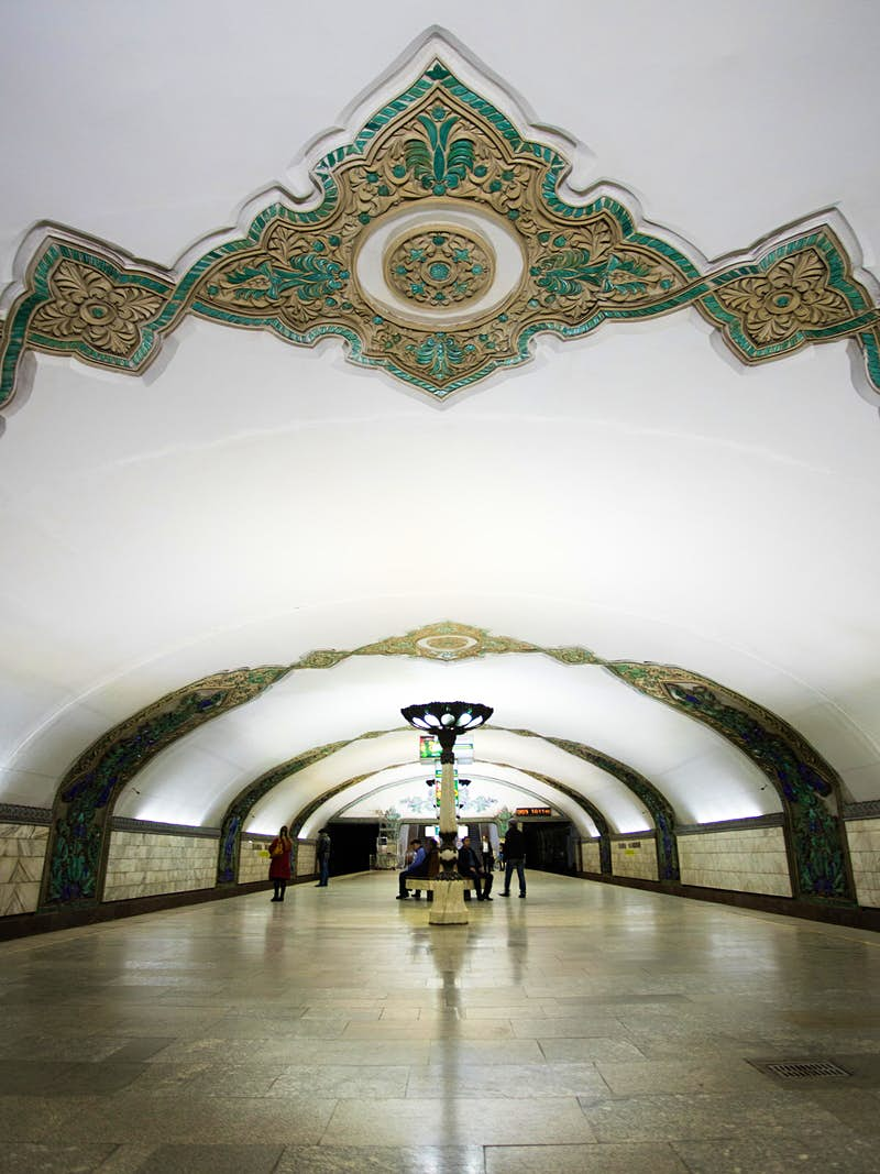 Khamid Olimjon station's mainly white domed ceiling decorated with geometric flourishes.