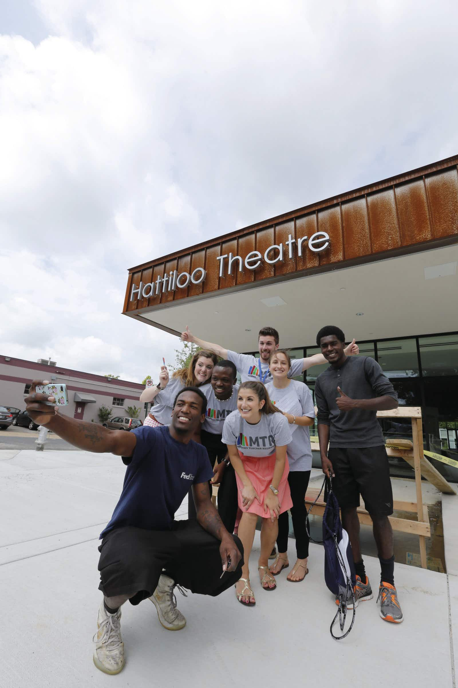 Group takes photo in front of modern-looking Hattiloo Theatre © Justin Fox Burks / Memphis Convention & Visitors Bureau