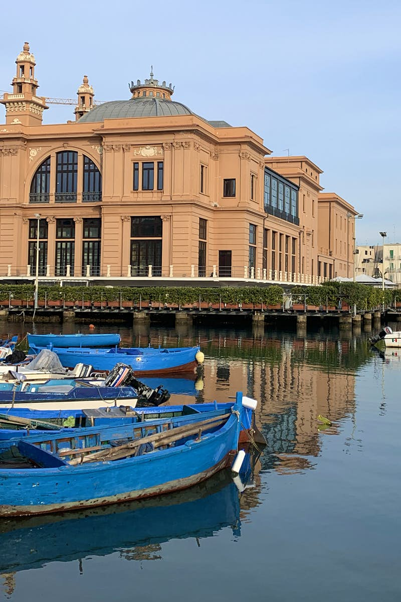 The peach coloured Art Nouveau Teatro Margherita sits right on the harbour