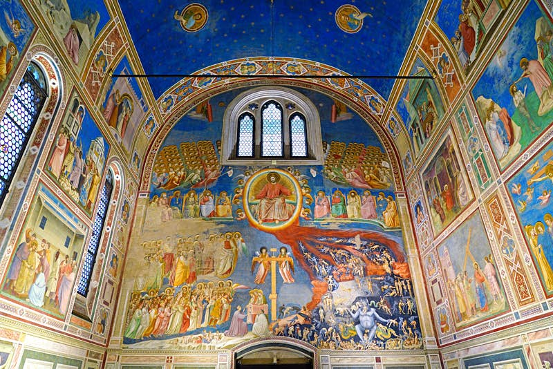 The frescoes in the Scrovegni Chapel, showing heaven on one side and hell on the other