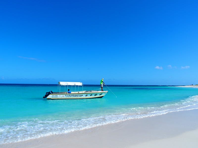 A glass-bottom boat makes its way to shore at Shoal Bay Beach in Anguilla