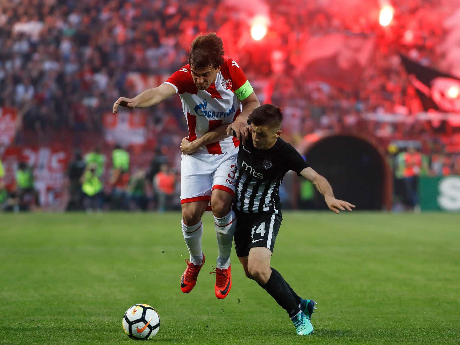 Red Star and Partizan players battle in a Serbian Super League match at Marakana stadium © Srdjan Stevanovic / Getty Images