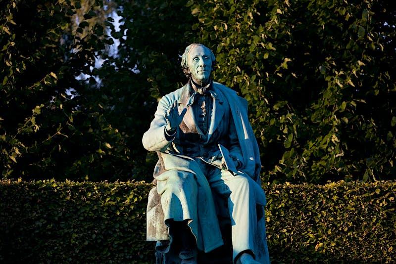 A statue of a sitting Hans Christian Andersen in Kings Garden in the centre of Copenhagen