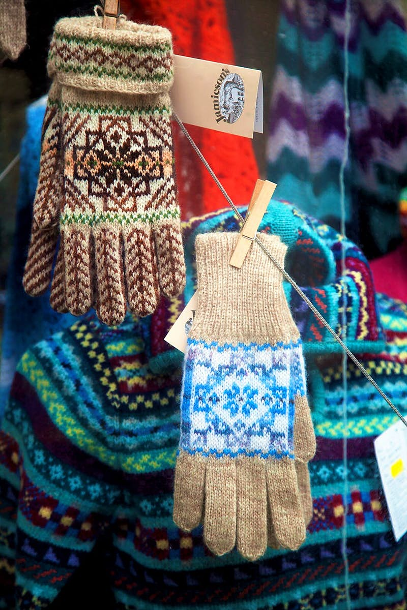 Some knitted gloves and other woollens in traditional Shetland designs